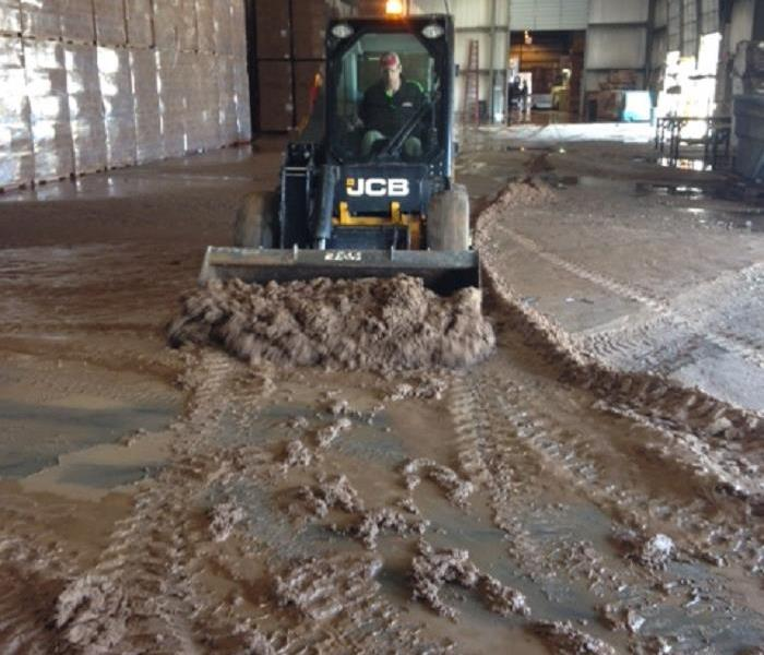 SERVPRO of East Brown County Removing mud at water main break flood of warehouse in Green Bay, WI