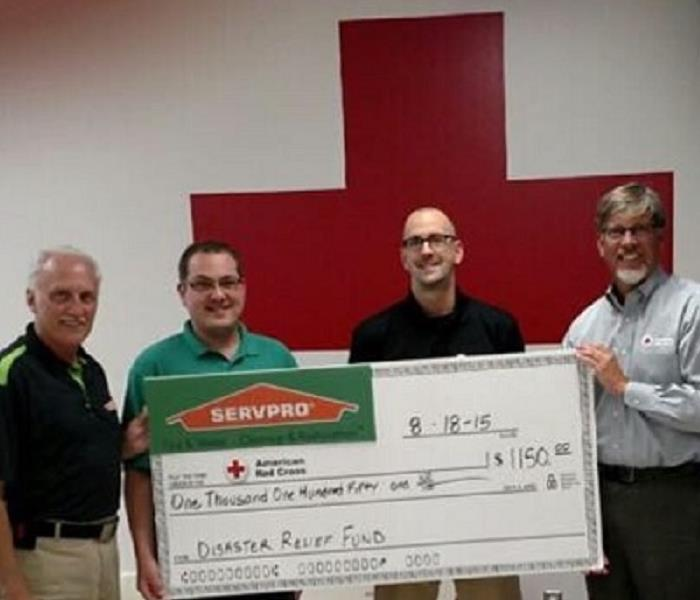 SERVPRO of East and West Brown County presents check to American Red Cross