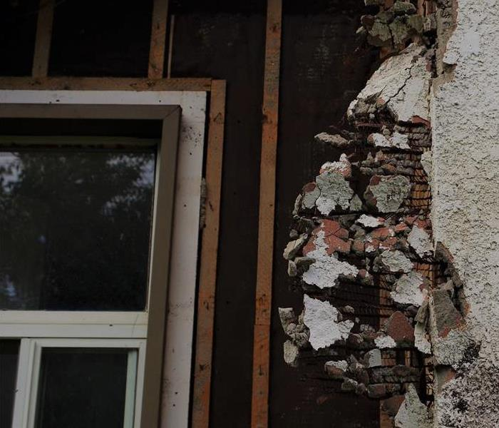 Exterior foundation on house is crumbling from weather damage